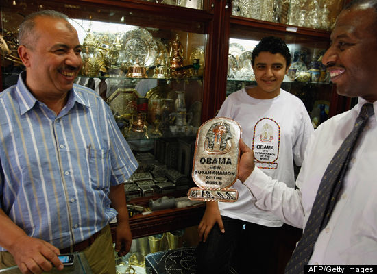 An Egyptian man buys a cartouche which reads 'Obama New Tutankhamon Of The World'
